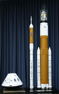 These models of the Orion crew exploration vehicle (left) and Ares I and Ares V (right) represent the spacecraft that'll soon travel to the moon. These spacecraft, or similar ones, could later be heading to Mars.