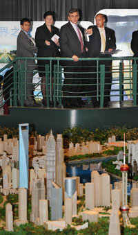 British and Chinese officials at the Urban Planning Museum in Shanghai, China, see a model of Shanghai in 2015.