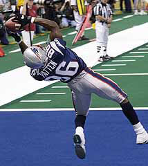 Super Bowl XXXVI: David Patten of the New England Patriots catches a touchdown pass in the second quarter.