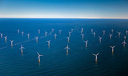 An aerial view of offshore wind turbines