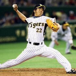 Pitching for a cursed team? Kyuji Fujikawa of the Hanshin Tigers pitches in a preseason game against the Boston Red Sox in 2008.