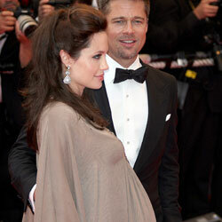 """Angelina's twins accompany Brad and her to the premiere of """"The Changeling""""  as a really big bump."""