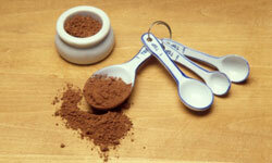 Cocoa makes a delicious dusting powder to use in concert with cupcake stencils.