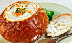 Don't have enough bowls to accommodate several varieties of soup? Use a crusty, round loaf of bread as the serving dish -- it'll be doubly delicious!