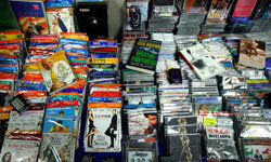 The goal of digital rights management software is to make it more difficult to create and sell bootleg DVDs, such as these.