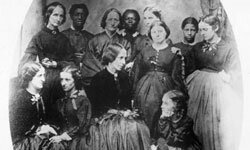 """Harriet Beecher Stowe, author of """"Uncle Tom's Cabin,"""" photographed with a group of anti-slavery workers"""