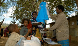 Women in the Babile district in eastern Ethiopia receive mosquito nets to help prevent malaria during the largest bed net distribution campaign in the history of Africa.