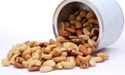 Keep some everlasting bar snacks on hand, such as a tin of salted nuts.