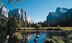 The beauty of Yosemite's peaks is reflected in placid blue water.