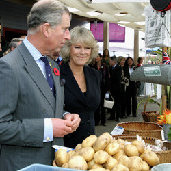 Prince Charles examines organic potatoes in California.