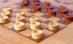 There are just 16 regulations in tournament level checkers play.