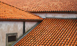 Clay tiles are an especially popular choice in hot climates because their curved shape allows for excellent ventilation. See more home construction pictures.