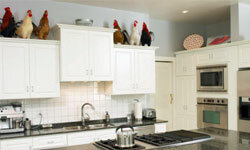 It was a clean, modern kitchen until someone decorated with roosters.