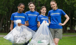 A simple act of good service -- like picking up trash around the community -- is a great way to introduce the concept of volunteering to your kids.