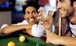 A pool table and a fully stocked bar are important elements of a classic man cave.