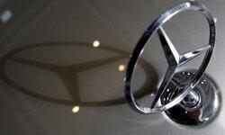 A Mercedes-Benz logo casts a shadow