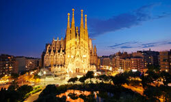 Gaudi's most famous work, the Cathedral of the Sagrada Familia, is lit up at dusk.