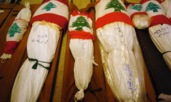A Muslim shroud is usually tied with four ropes: one above the head, one below the feet and two around the body.