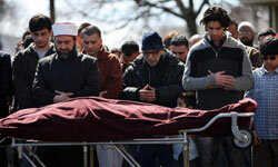 Muslim mourners pray over a lost loved one in New York in 2009.