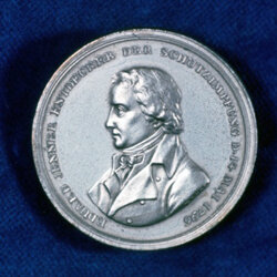Edward Jenner, commemorated here on a coin, found that inoculating people with cowpox could build immunity to smallpox.