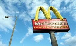 McDonald's golden arches catch sunlight.