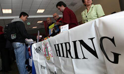In the thick of the recession, a college student talks to recruiters at a 2009 job fair.
