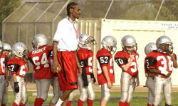 Yes, that's rapper Snoop Dogg coaching the Chino Hills Pop Warner Football Team.