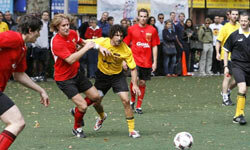 """Grassroot soccer organizer and """"Survivor"""" winner Ethan Zohn (yellow shirt) plays in the Grassroot Soccer UNITED celebrity soccer match in New York City in 2008."""
