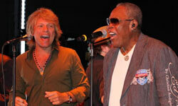 Jon Bon Jovi (left) performs with Sam Moore during the Apollo In The Hamptons fundraiser in August 2010 in East Hampton, New York.