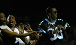 """Sean """"P. Diddy"""" Combs gets his groove on during the halftime show at Super Bowl XXXVIII in Houston."""