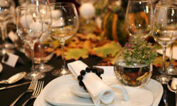 For an eco-chic vibe, decorate tables with leaves and freshly collected greenery. This harvest-themed setting reflects the season and the bride's environmental consciousness.