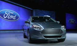 The brand new all-electric Ford Focus is displayed at the 2011 International Consumer Electronics Show in Las Vegas, Nev.