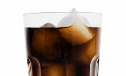 Add a flair to soda with lemon juice ice cubes.