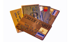 Some scammers will offer to attempt to reduce your credit card debt -- for a fee.