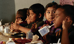 Schoolmates finish up lunch.