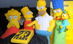 "Image Gallery: TV Shows ""The Simpsons"" paved the way for many adult cartoons to come. Here, the characters celebrate at a 20th-anniversary party. See more pictures of TV shows."