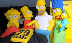 """""""The Simpsons"""" paved the way for many adult cartoons to come. Here, the characters celebrate at a 20th-anniversary party."""
