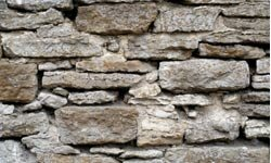 Fieldstones can make a garden wall look rugged and charming.