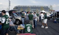 These New York Jets fans enjoyed a tailgate party in the parking lot of the New Meadowlands Stadium on Sept. 13, 2010. Getting to know your neighboring tailgaters is all part of the fun.