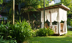 Turn the gazebo in your backyard into a summertime cabana by hanging up gauzy white curtains.