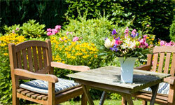 A summer garden tablescape just needs flowers, linens and pretty pottery.