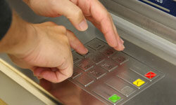 Covering the keypad with your hand when you type in your PIN can help prevent theft.