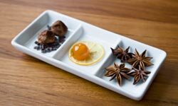 Chocolate truffles with candied kumquat and star anise, a spice that tastes similar to regular anise.