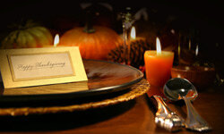 Create a simple yet elegant tablescape for Thanksgiving with fall colors and autumn produce.