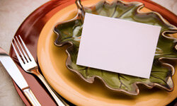 You can use autumn-themed dinnerware to bring extra color to your tablescape, and place cards give you space to express yourself.
