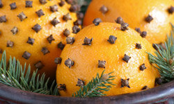 Clove-studded oranges with rosemary add a great scent to your sensational autumn tablescape.