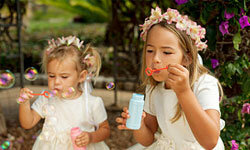 Flower girls can toss petals and blow bubbles at the send-off.