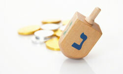 Dreidels are used in a traditional game that has become a fun part of Hanukkah tradition.