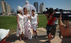 These models are wearing dresses made entirely of toilet paper! It was part of a design competition in Israel in 2009.