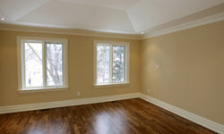 Crisp white baseboards attract attention to these beautiful wooden floors.